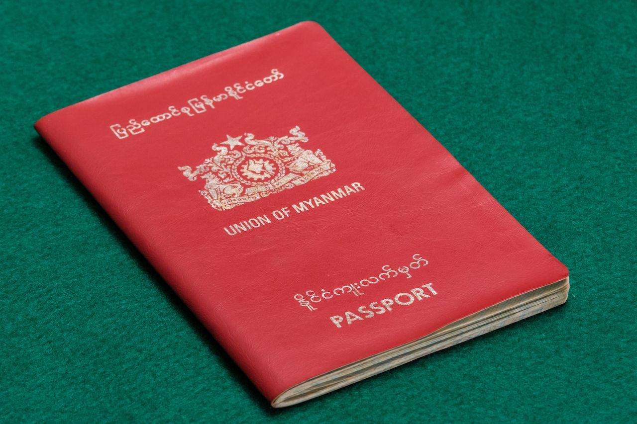 Myanmar Burmese passport on green table, weakest passports