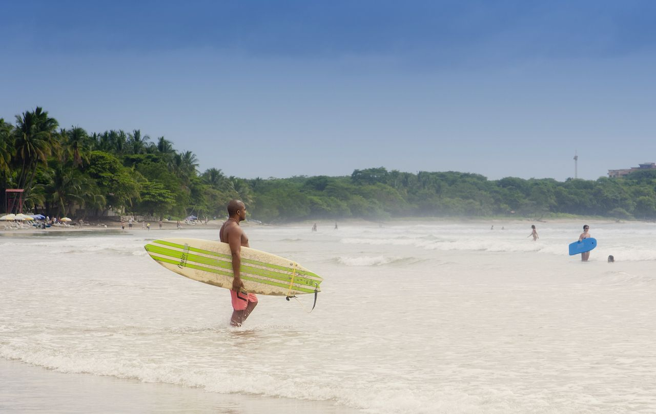 Tamarindo,,Costa,Rica,-,September,13,,2008:,Young,Afro-american,Man,  beach town for solo travelers