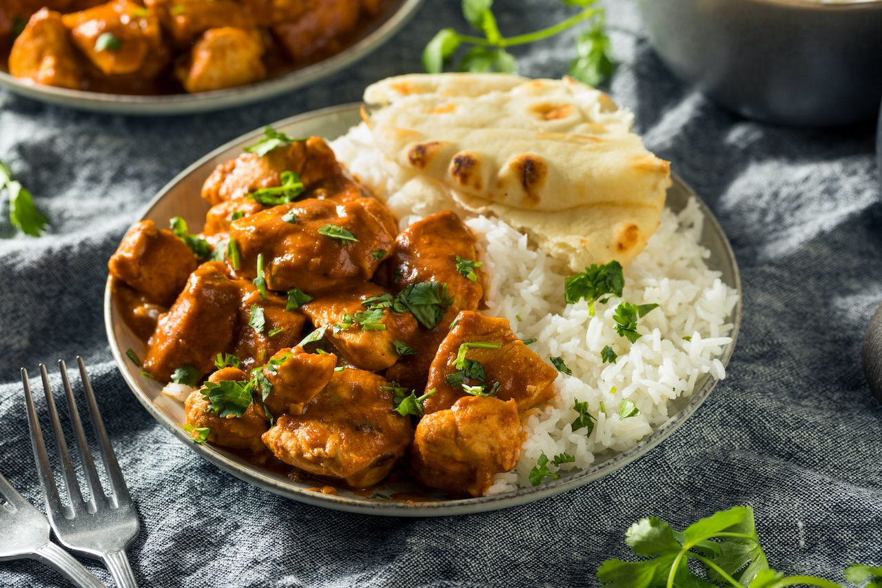 Homemade,Chicken,Tikka,Masala,With,Rice,And,Naan, Difference between butter chicken and chicken tikka masala