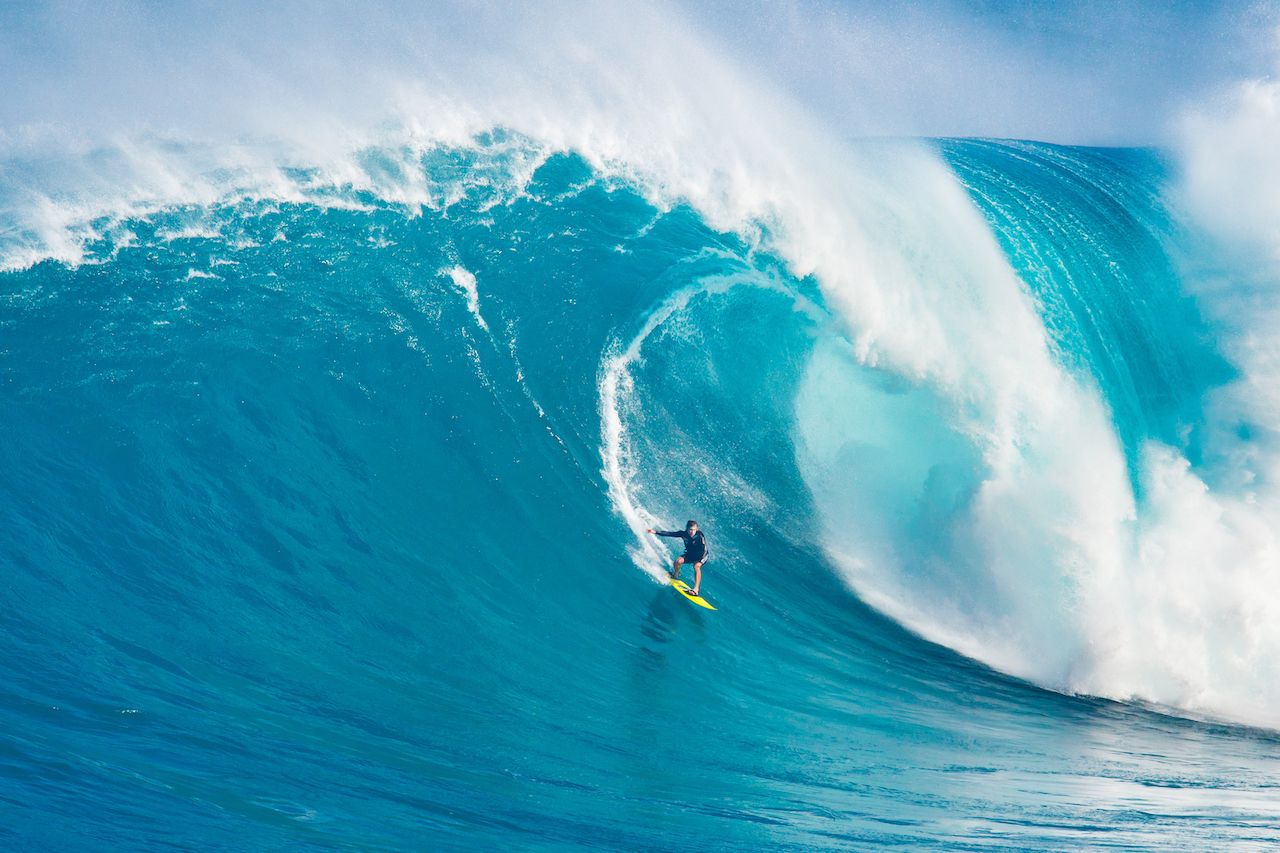 """MAUI, HI - MARCH 13: Professional surfer Carlos Burle rides a giant wave at the legendary big wave surf break """"Jaws"""" during one the largest swells of the winter March 13, 2011 in Maui, HI., US Olympic surf team"""