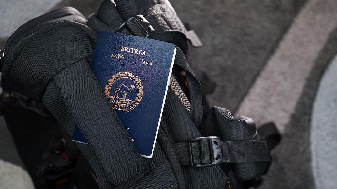 ERITREA Passport on a Black Suitcase Travel Bag - Eritrean, weakest passports
