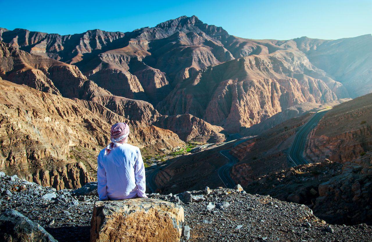 Arab,Man,Enjoying,The,View,At,The,Jebel,Jais,Desert,  week in Dubai