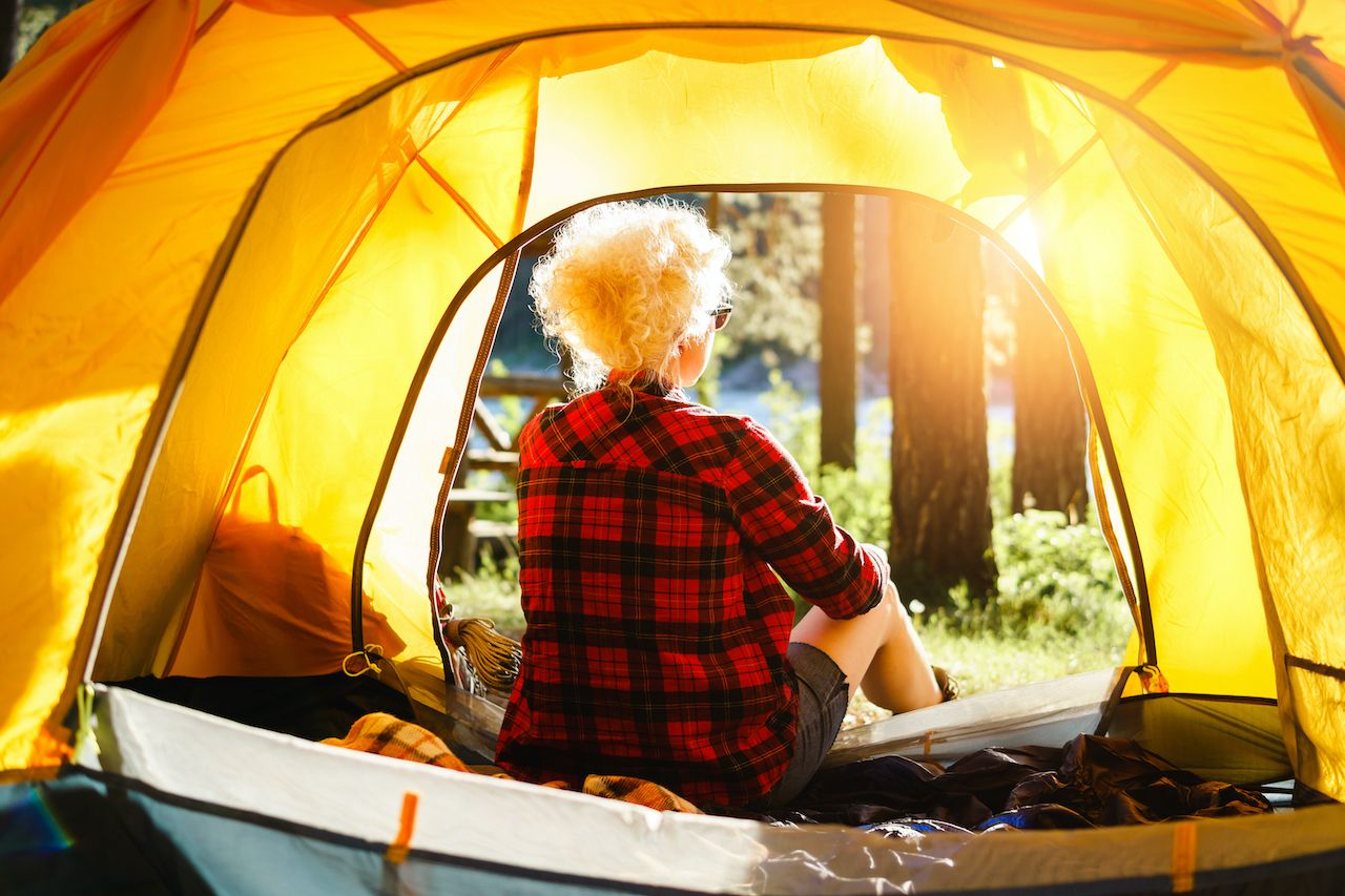 Woman,Sitting,In,A,Tent,Enjoying,The,Rays,Of,The, LGBTQ campgrounds
