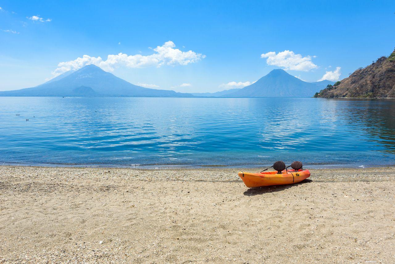 Paradise,Beach,With,Chair,And,Kayak,At,Lake,Atitlan,,Panajachel