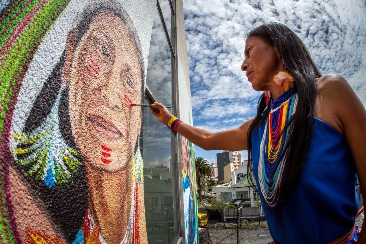 Mona-Caron-Indigenous-woman-painting