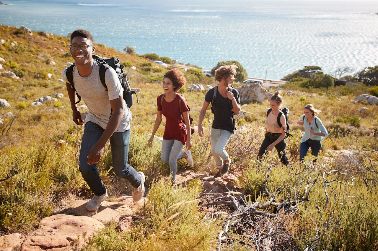 Happy,Young,Adult,Friends,Hiking,Single,File,Uphill,On,A