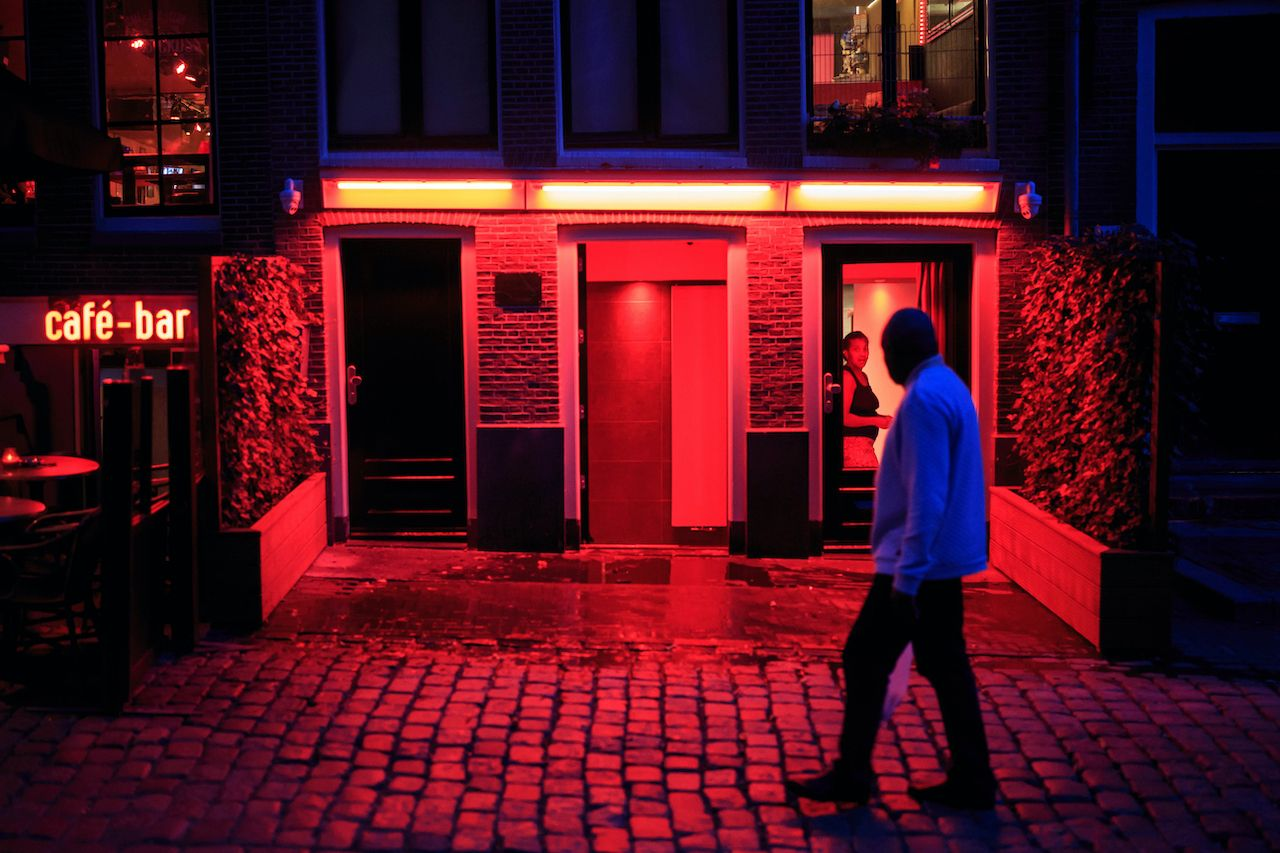 Amsterdam, Netherlands - September 4, 2018: Man walks on street in, Red Light district