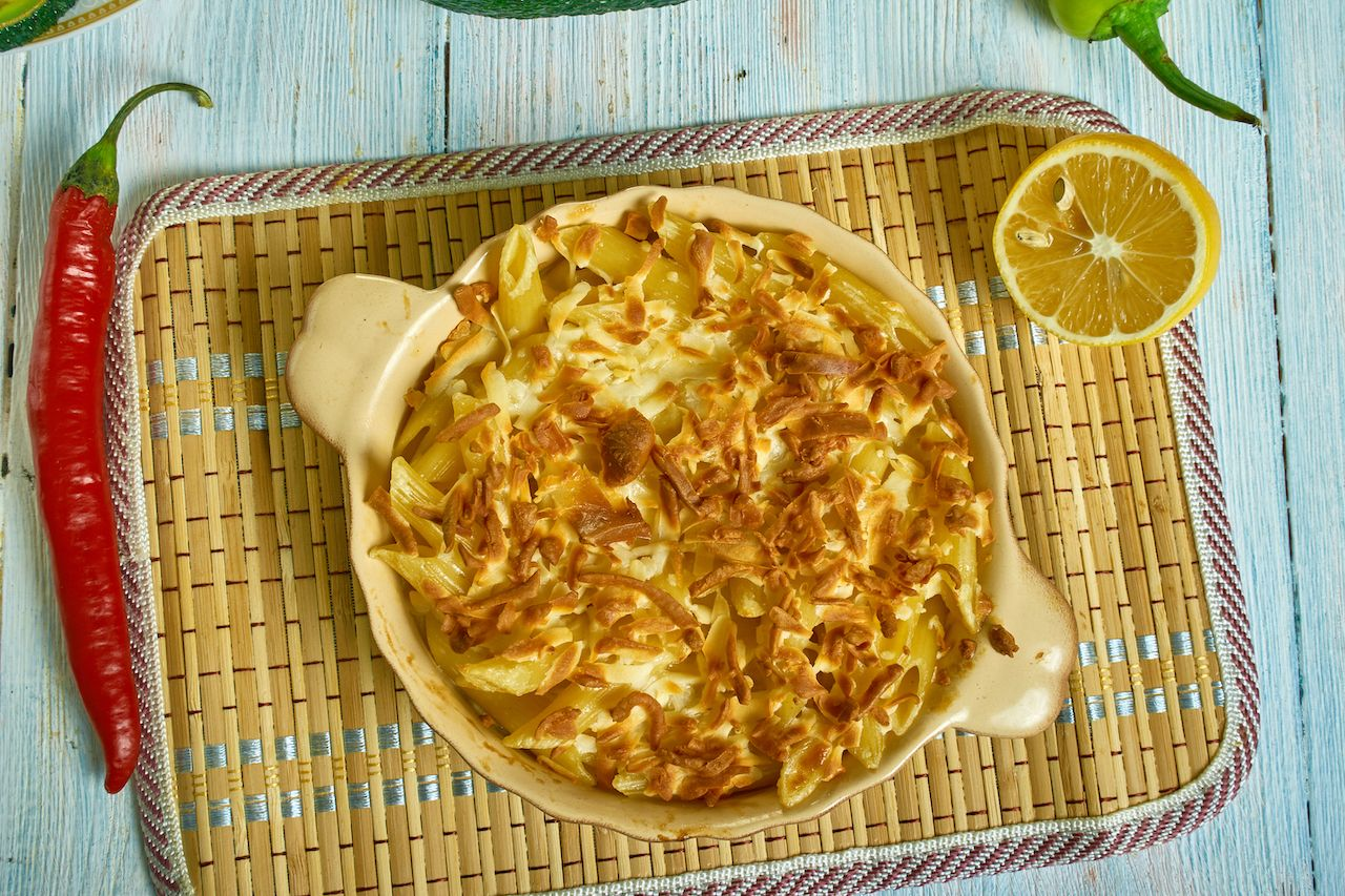 Macaroni and Cheese Pie, Caribbean cuisine, Traditional assorted  dishes, Top view., mac and cheese