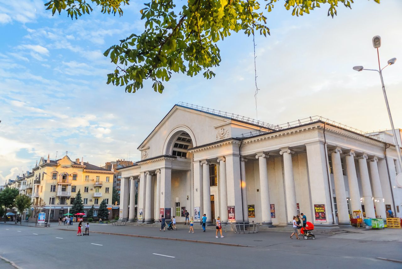 KRYVYI RIH, UKRAINE - 18 of July 2018: Shevchenko theatre at sunset with crowds of people.