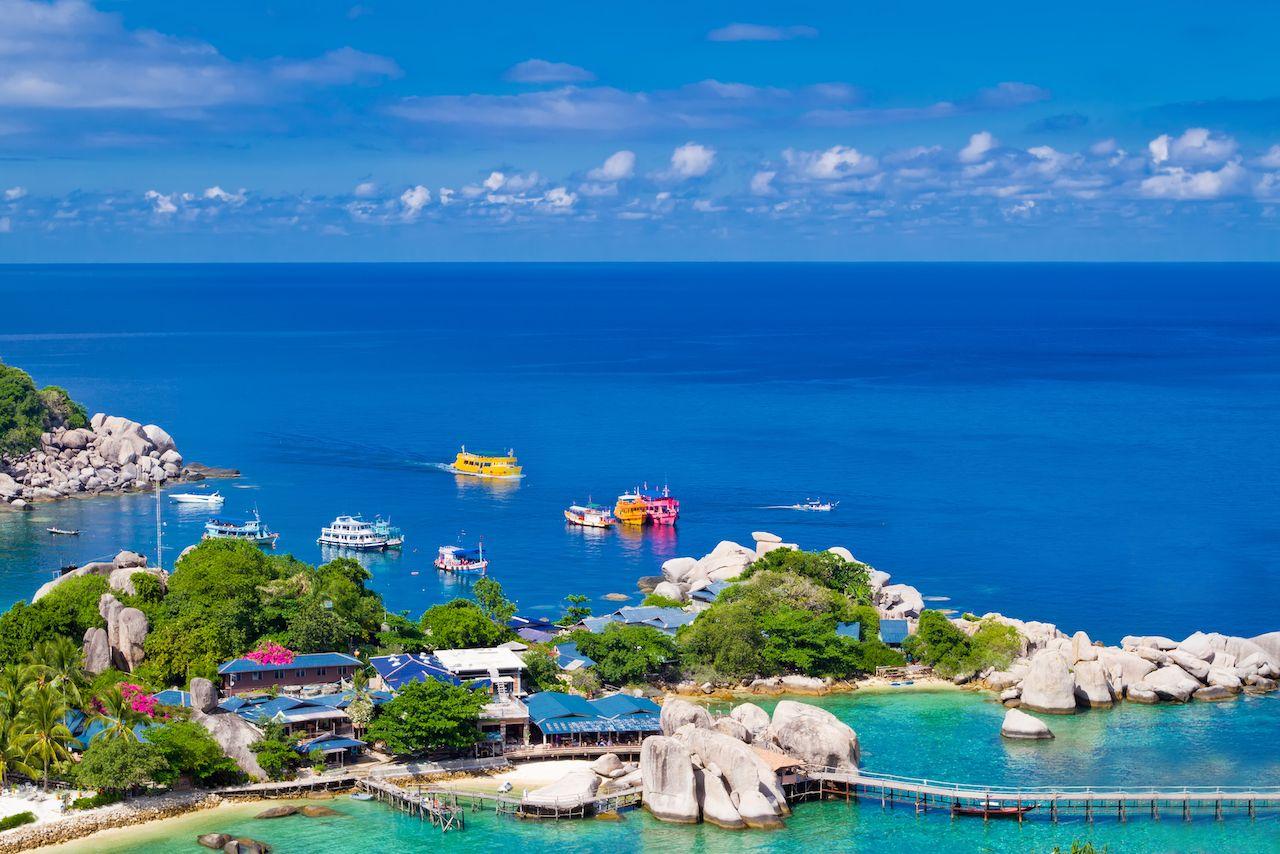 Marina pier of beautiful tropical island. Koh Phangan island, Kingdom of Thailand, sandbox program