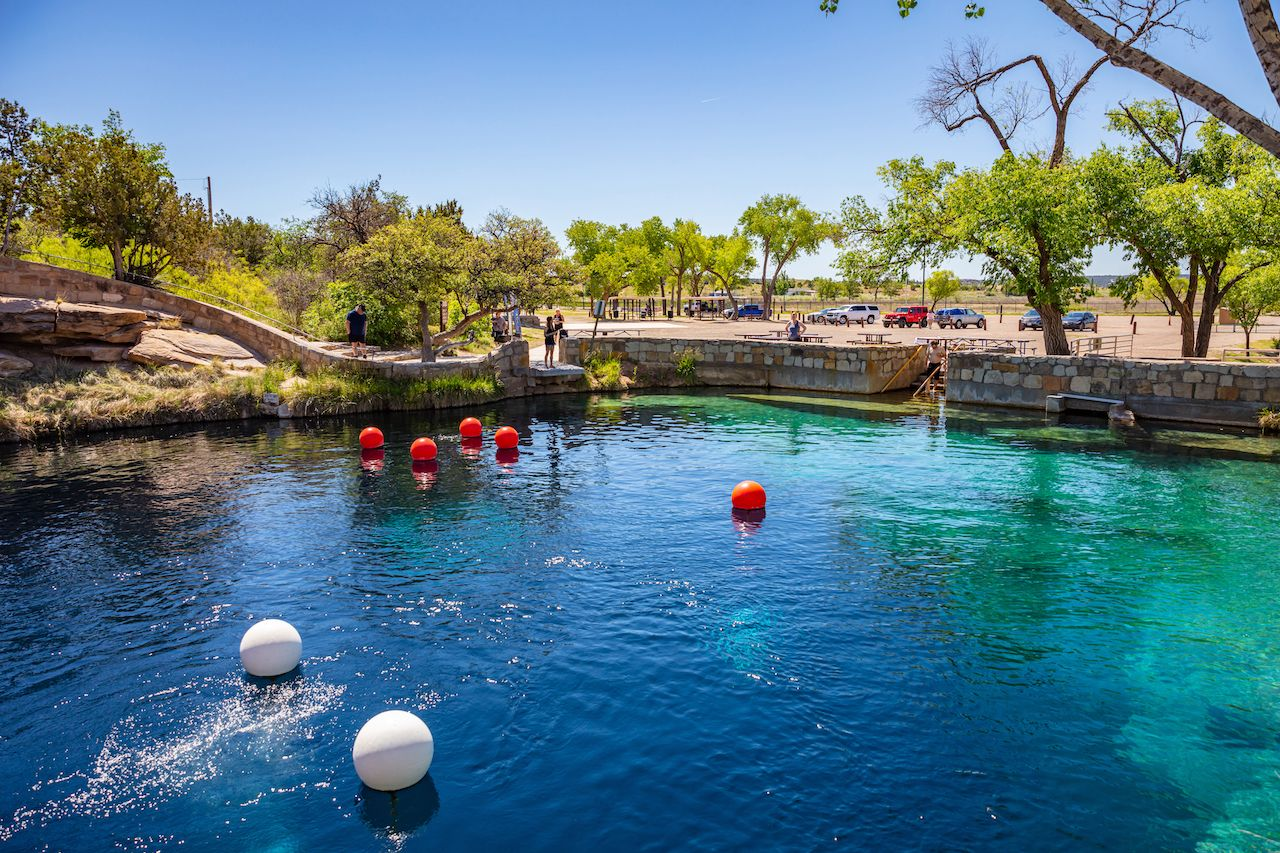 White and red bouys mark dive spots at the Blue Hole famous cenote in Santa Rosa, New Mexico