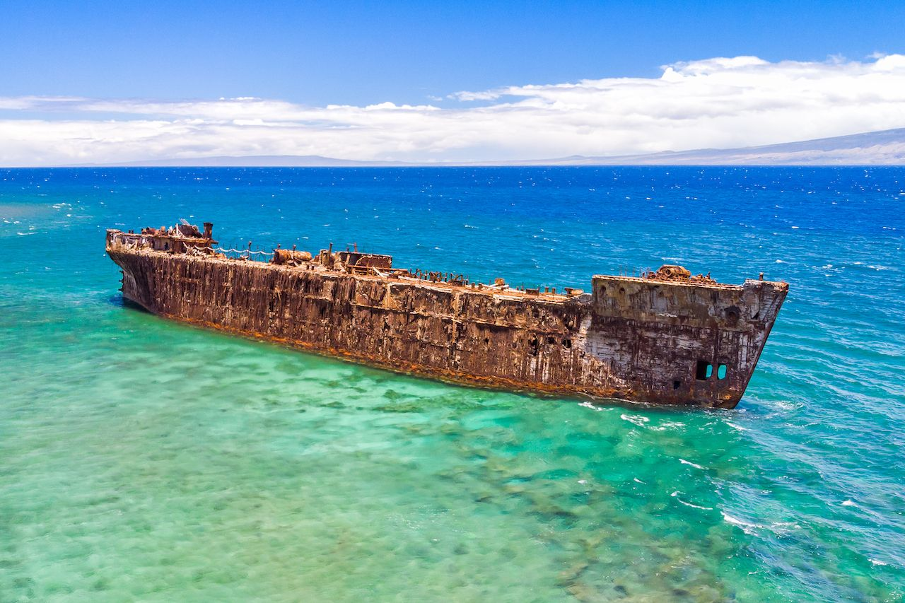 A rusty shipwreck off the coast of ShipWreck Beach on the Island of, Lanai by Jeep