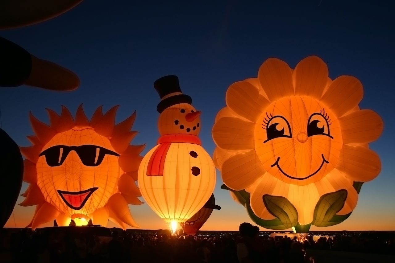 Glowing balloons in the sky at the Albuquerque International Balloon Festival