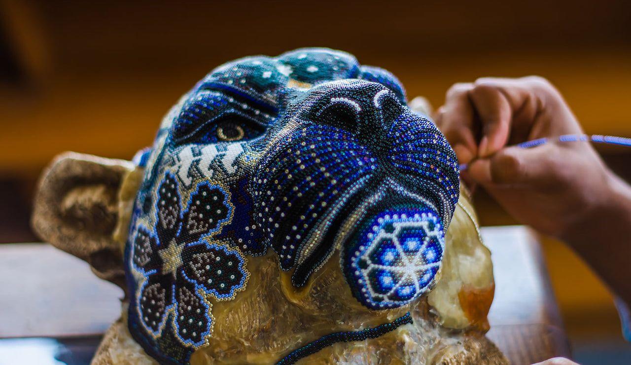 Mexican artisan making Huichol, a beautiful beaded artwork