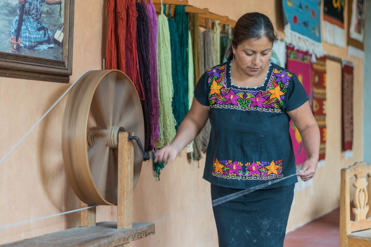 Artisan woman wearing a Huipil blouse in Mexico