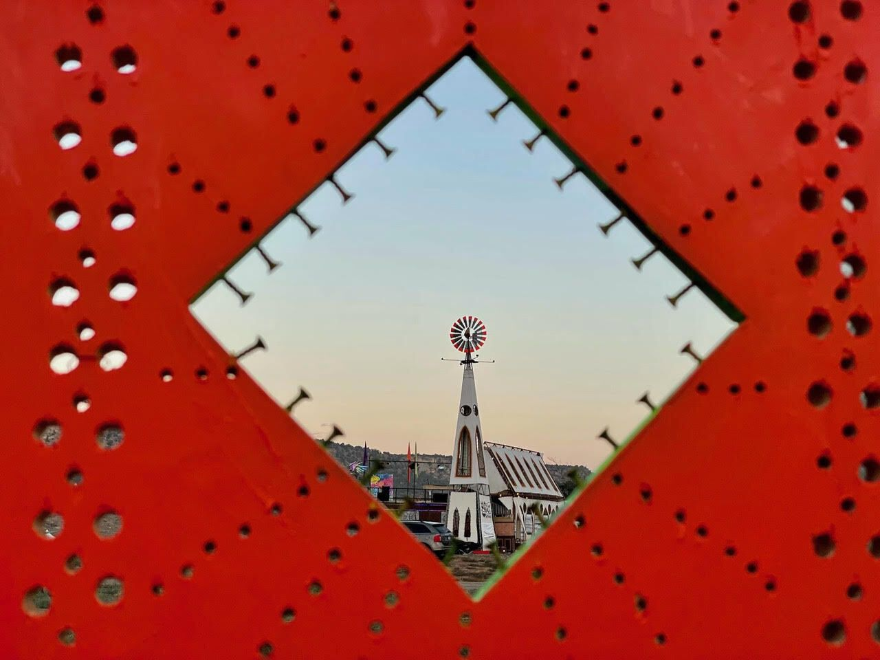 View of windmill through a red diamond