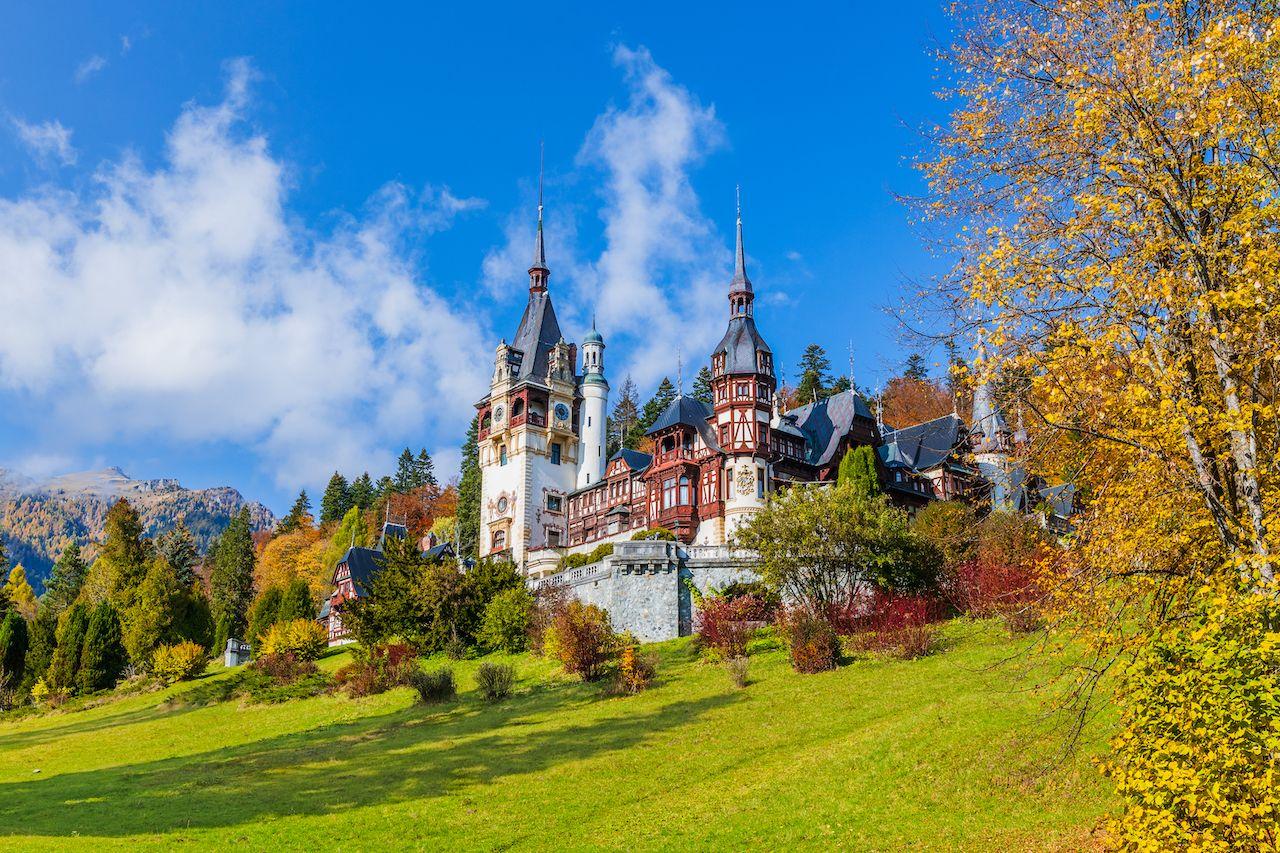 gay friendly places eastern europe Peles castle in autumn. Sinaia, Prahova county, Romania.