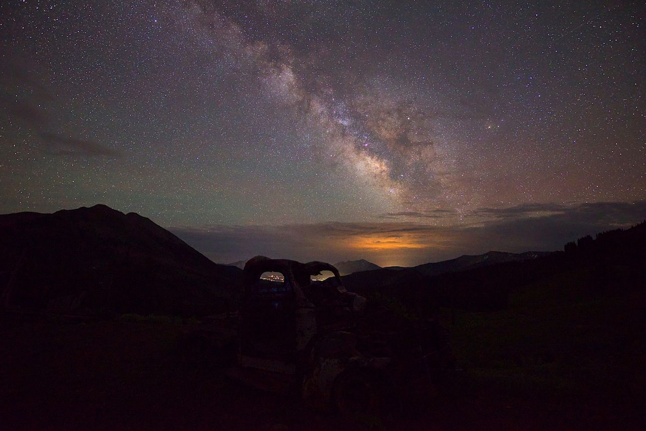 Milky Way visible behind mountain silhouettes