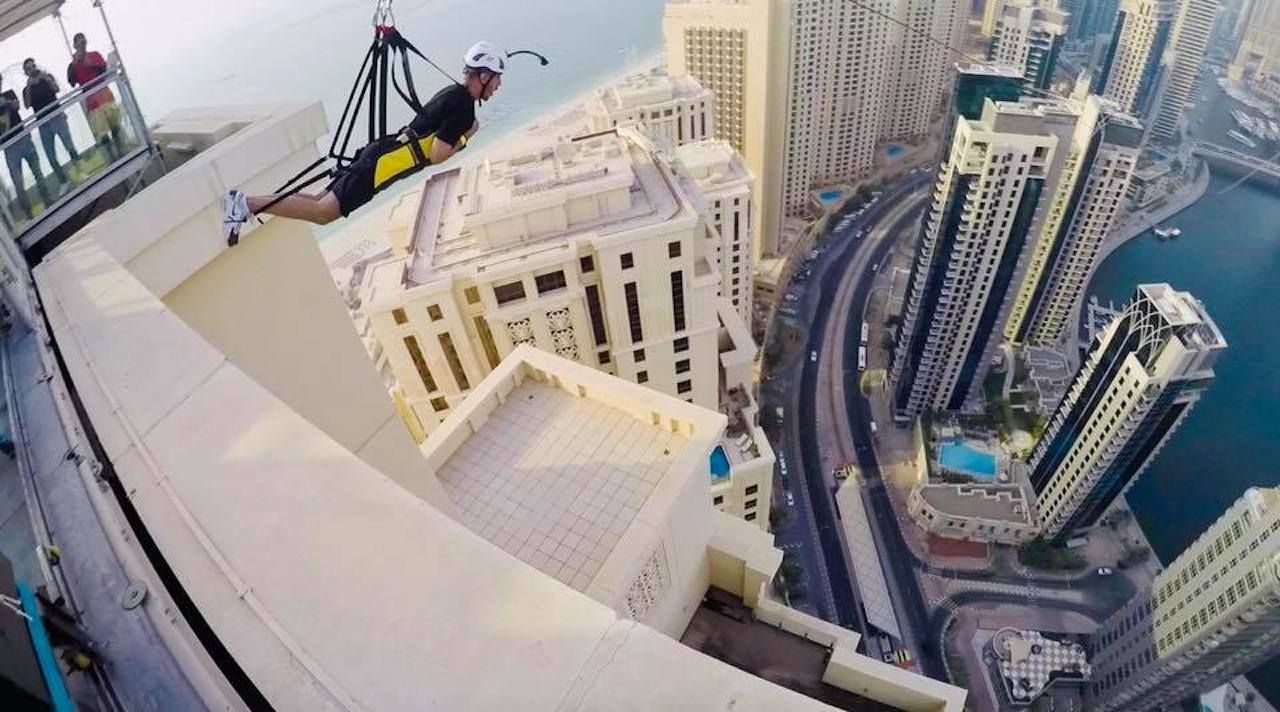 Person about to biplane amid the buildings in Dubai