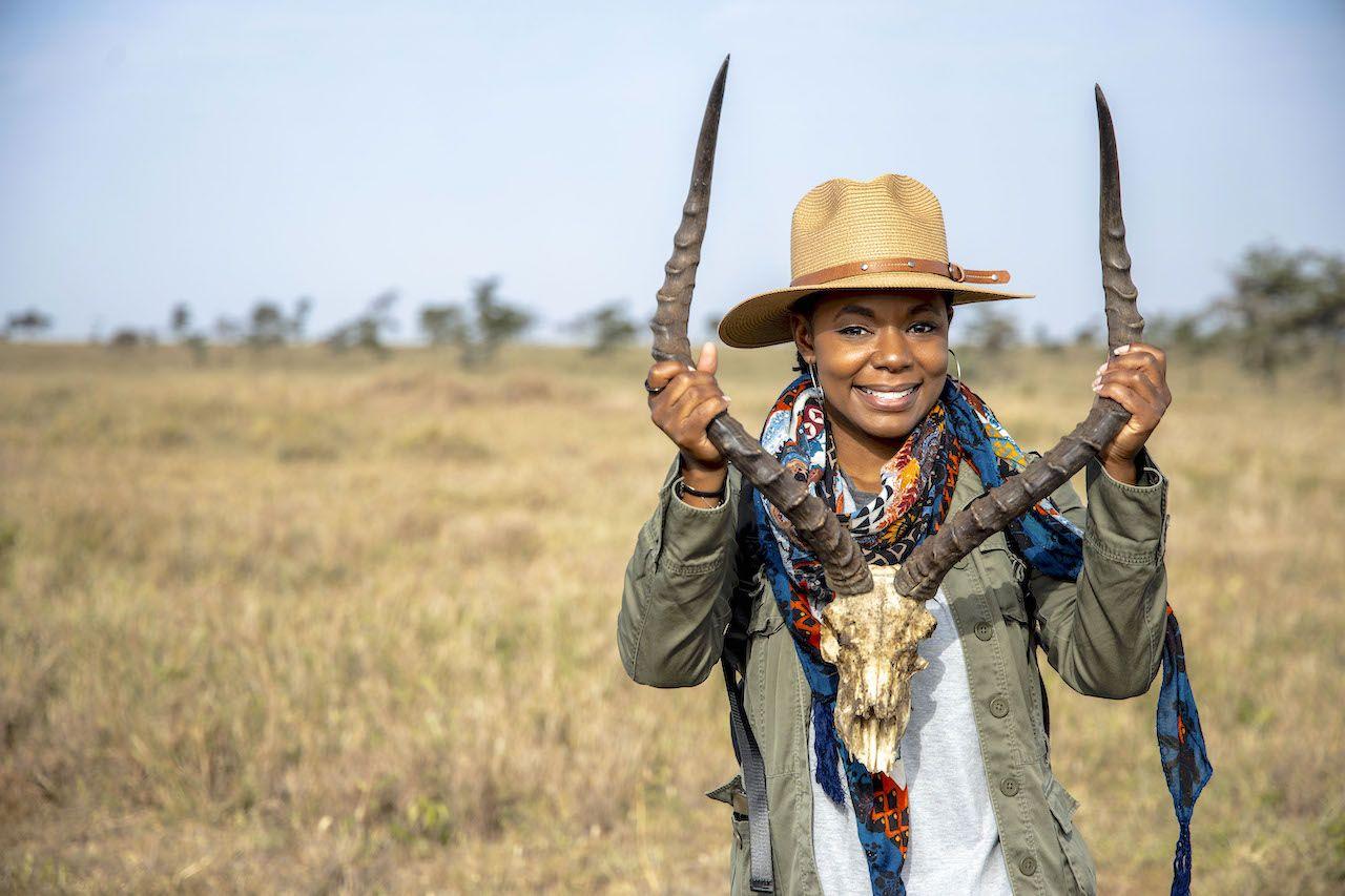 Journalist on safari smiling