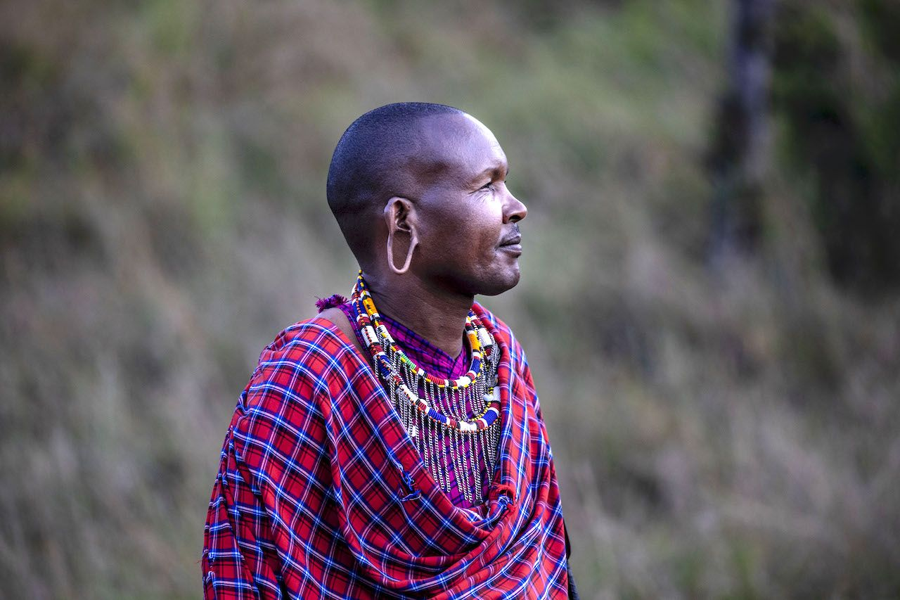 Profile of a Maasai in traditional garb