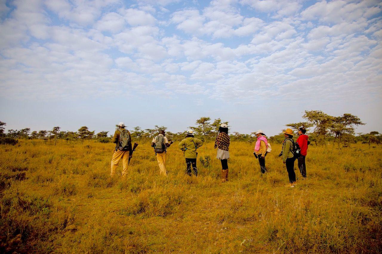 Guides and travelers on a walking safari in Kenya
