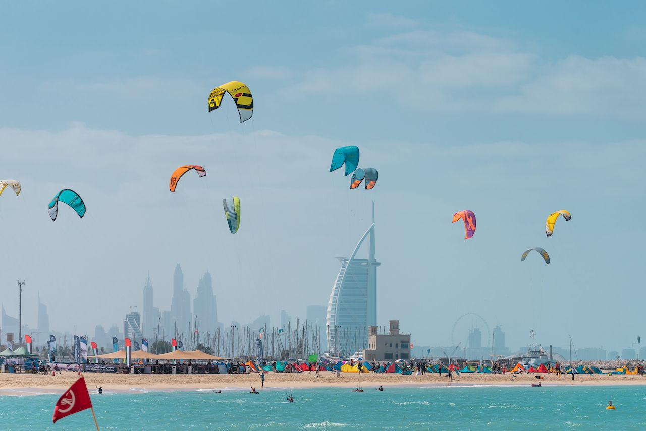 A view of colorful kite belonging to Kite surfers flying over Kite beach in the sky of Dubai