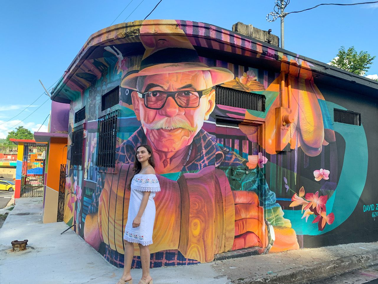 Young woman in front of street art in Puerto Rico