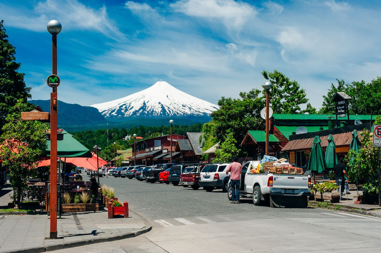 Street scene in Pucon with Villarrica, one of Chile's most active volcanoes, in background.