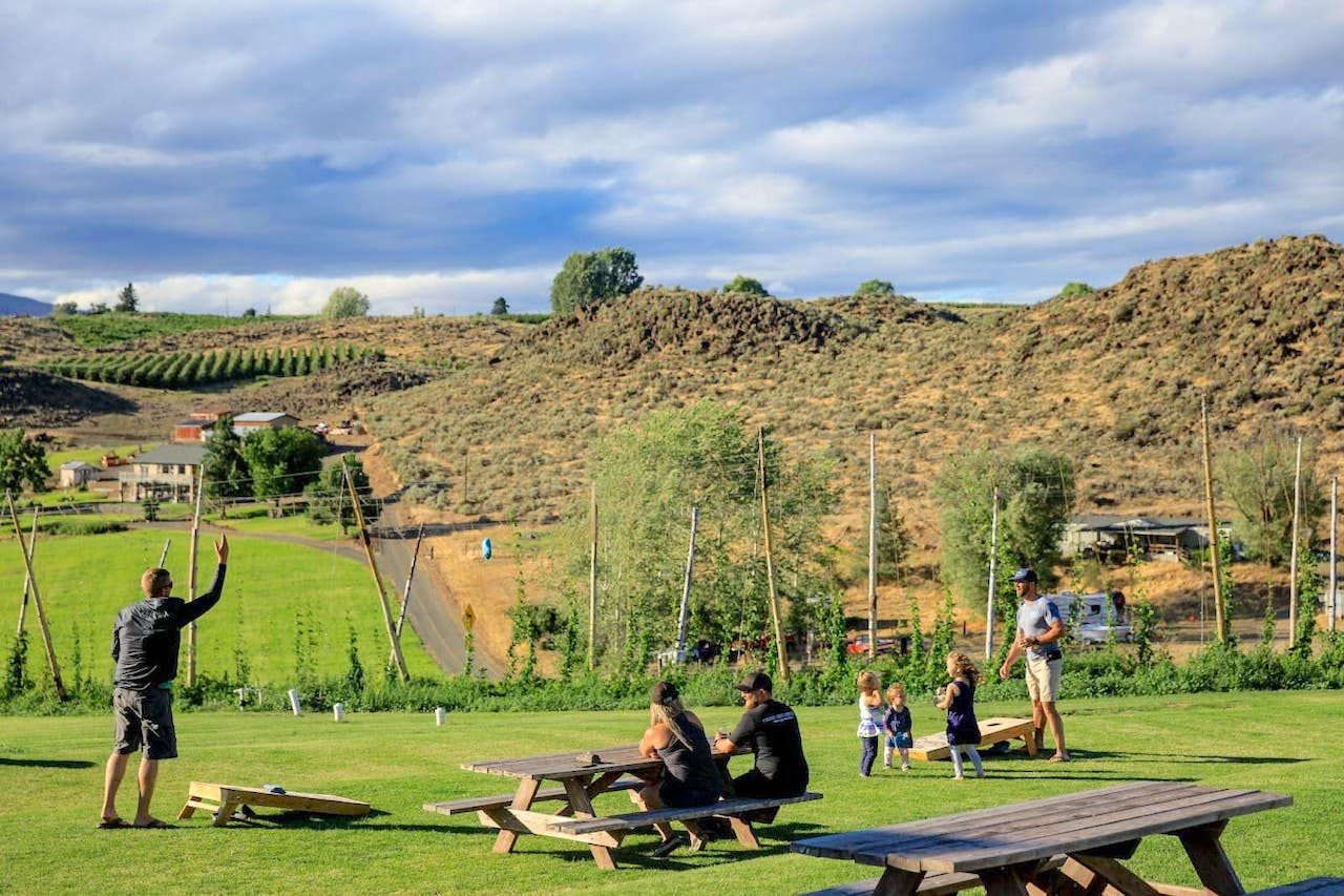 People relaxing outside at Cowiche Creek Brewing Company