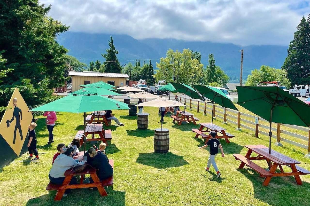 Tables outside on grass at Walking Man Brewing